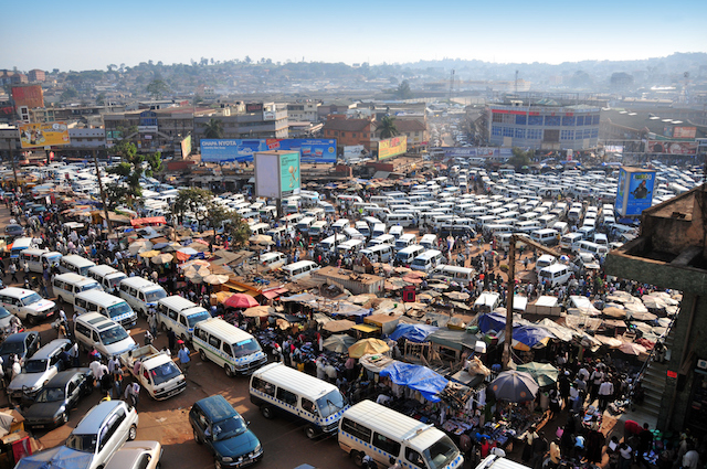 Kampala, Uganda - August 18, 2010: share taxi chaos at the Old Taxi Park - chaotic aglomeration of matatu share taxis, seems almost impossible that they can leave